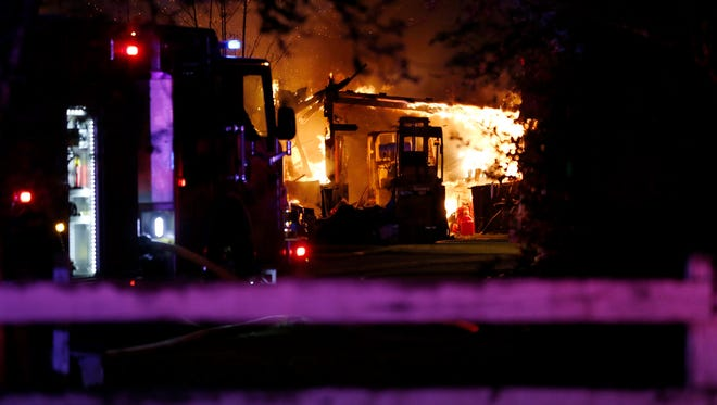 A fire destroyed a garage with several classic cars Monday evening east of Salem.