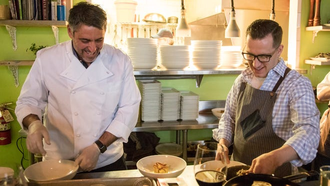 "Luciano Del Signore, left, talks to James Rigato, as they prepare for the second course during post-film dinner at Chartreuse Kitchen & Cocktails in Detroit, Sunday, April 15, 2018. Guests attended the screening of the film ""Dinner in Abruzzo"" before heading the Chartreuse for a meal prepared by the two chefs featured in the film."