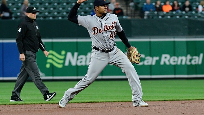 Tigers third baseman Jeimer Candelario (46) throws to first base for the force out of Orioles designated hitter Pedro Alvarez (not pictured) during the second inning on Friday, April 27, 2018, in Baltimore.