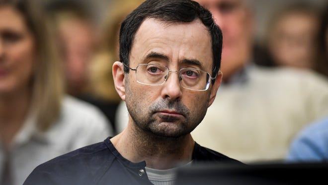 In a recently filed lawsuits against Michigan State University, a former field hockey player says Larry Nassar drugged and raped her during a medical appointment in 1992.