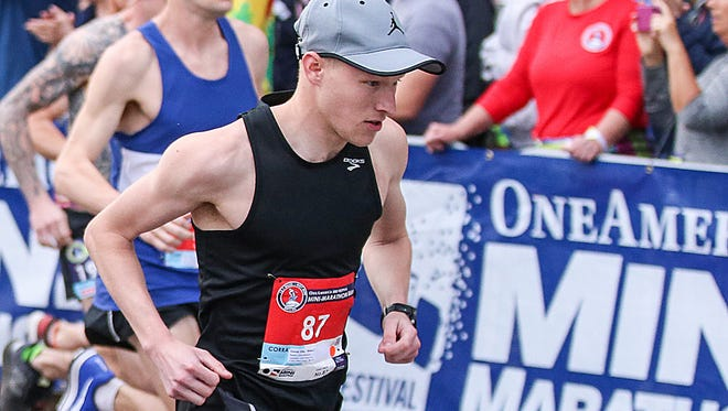 John Mascari, a former Indiana State runner, leaves the starting line at the OneAmerica 500 Festival Mini-Marathon in Indianapolis, Saturday, May 5, 2018. Mascari finished second in the men's division.