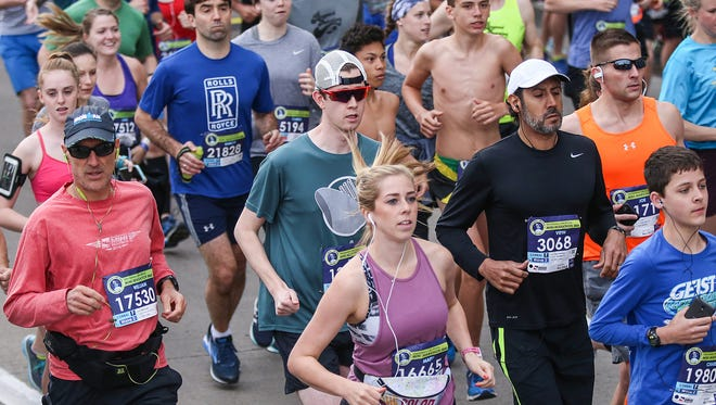 Runners leave the starting line at the OneAmerica 500 Festival Mini-Marathon in Indianapolis, Saturday, May 5, 2018.