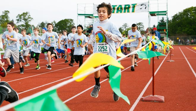 Salem Heights fifth grader Max Westbye begins his run at the 36th annual Awesome 3000 on Saturday, May 5, 2018, at McCulloch Stadium in Salem, Ore.