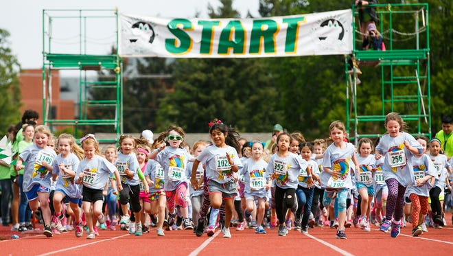 Kindergarten girls run in the 36th annual Awesome 3000 on Saturday, May 5, 2018, at McCulloch Stadium in Salem, Ore.