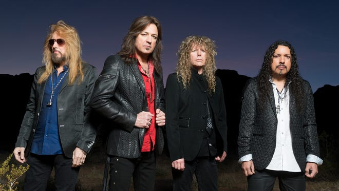 """Michael Sweet, second from left, with Stryper. The band's new album, the provocatively titled """"God Damn Evil,"""" arrived in April."""