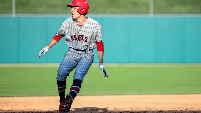 Roncalli Rebel Harrison Koppenhofer (20) runs a two-RBI double in the bottom to the sixth inning of the Marion County tournament final at Victory Field in Indianapolis, Monday, May 14, 2018. Roncalli won the Marion County title, 5-3.