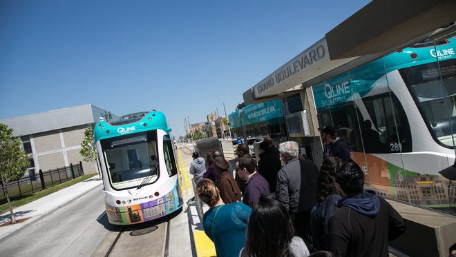 People ride the QLINE during the grand opening festivities in downtown Detroit in May 2017.