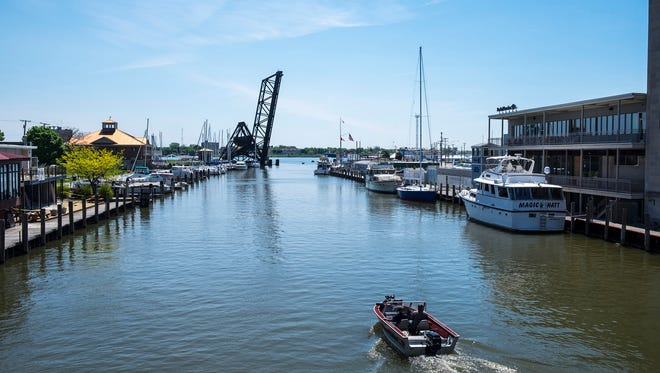 A fishing boat heads out to the St. Clair River on the Black River, Wednesday, May 23, 2018.