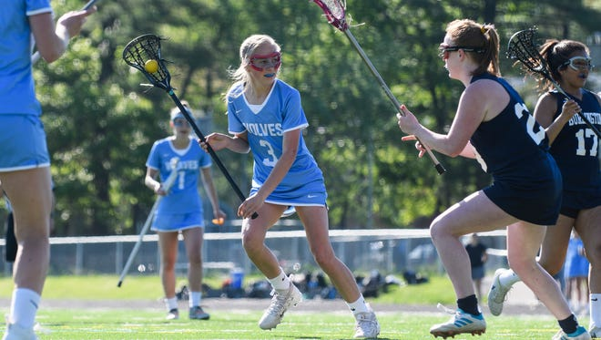South Burlington's Lindsey Booth looks for a shot during the 2018 high school girls lacrosse season. Wednesday, Booth's three-goal, two-assist effort led the Wolves past Woodstock 14-7.