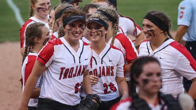 The Center Grove Trojans celebrate defeating the Shelbyville Golden Bears, 2-0, in softball regionals at Center Grove Middle School Central in Greenwood, Ind., Tuesday, May 29, 2018. Center Grove defeated Shelbyville, 2-0.