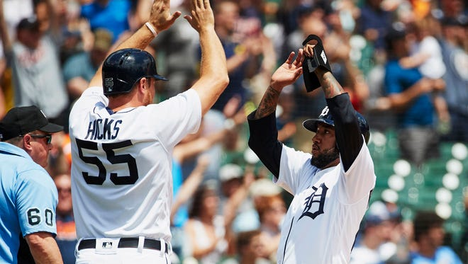 Tigers first baseman John Hicks (55) and second baseman Ronny Rodriguez (60) congratulate each other after scoring in the first inning on Thursday, May 31, 2018, in Comerica Park.