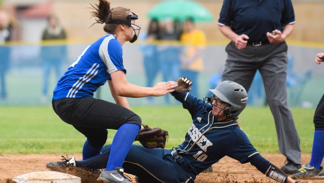 Essex's Makenna Thorne (10) slides safety into second base under the tag by Colchester's Sophie Comi (11) during the Division I high school softball semifinal game between the Colchester Lakers and the Essex Hornets earlier this month.