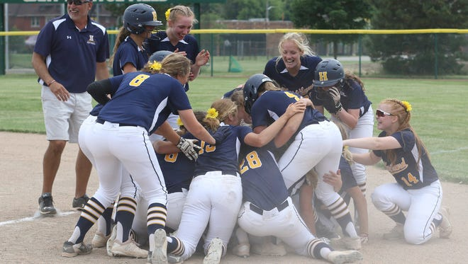 Hartland celebrates a 3-2 victory over Clarkston in the state Division 1 softball quarterfinals at Wayne State on Tuesday, June 12, 2018.