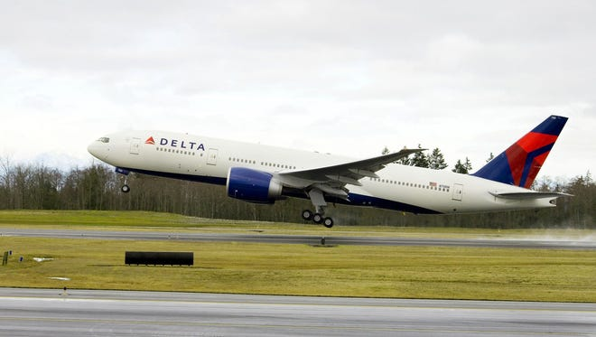 This undated file photo shows one of Delta's Boeing 777 aircraft.
