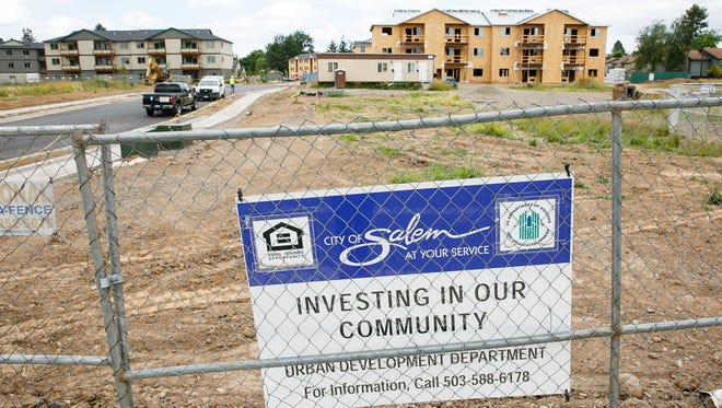 Apartments under construction on Portland Road NE, south of Carleton Way NE, on Friday, June 15, 2018. The lot will have 188 affordable housing units when finished.