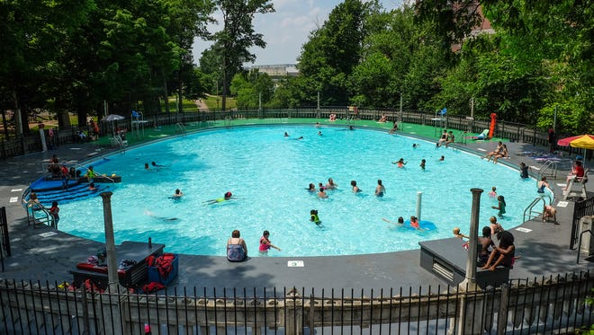 Moores Park Pool has a unique ovoid design and is built into the side of a hill. It is owned by the city of Lansing and is free to the public. Sunday, June 17, 2018.