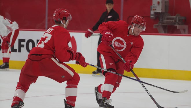 Red Wings prospect Filip Zadina, right, controls the puck in development camp at the Belfor Training Center in Detroit on June 27.