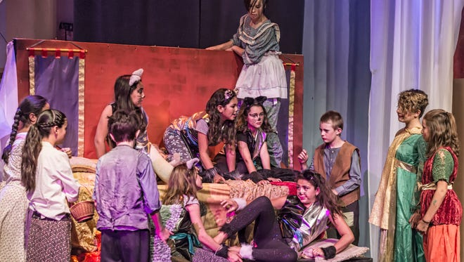 Young actors in the Virus Theater perform in an original play titled The Red Stilts.
