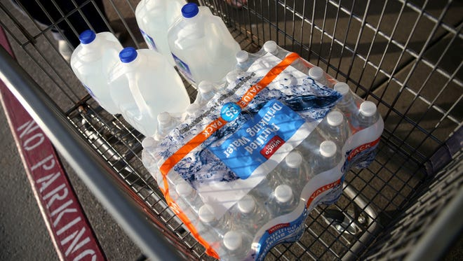 Loren and Linda Stratton of Turner purchased this water at WinCo Foods after a tap water contamination warning in Salem on May 29.  ANNA REED/Statesman Journal file Water purchased by Loren and Linda Stratton, of Turner, following a tap water contamination warning at WinCo Foods on Lancaster in Salem on Tuesday, May 29, 2018.