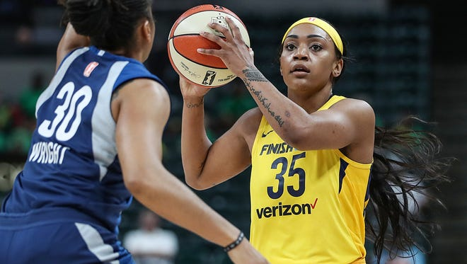 Minnesota Lynx guard Tanisha Wright (30) guards Indiana Fever guard Victoria Vivians (35) as she works a possession during first half game action at Banker's Life Fieldhouse in Indianapolis, Wednesday, July 11, 2018. The Fever lost to the Lynx, 87-65.