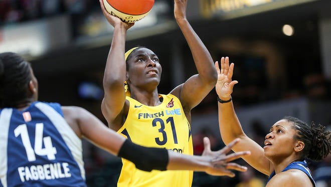 Center, Indiana Fever forward Asia Taylor (31) shoots during second half action at Banker's Life Fieldhouse in Indianapolis, Wednesday, July 11, 2018. The Fever lost to the Lynx, 87-65.