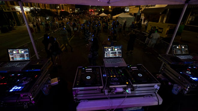 People dance at the silent disco on Boat Night Friday, July 13, 2018 during Boat Week in Port Huron.
