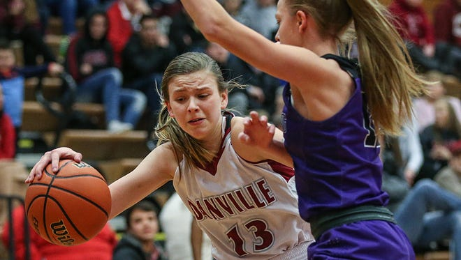 Collier fights toward the basket against the Brownsburg Bulldogs'  Mackenzie Bedrick. Brownsburg defeated Danville in the Hendricks County semifinals in January.