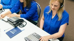 Jennifer Ilich (R), director of helpline operations