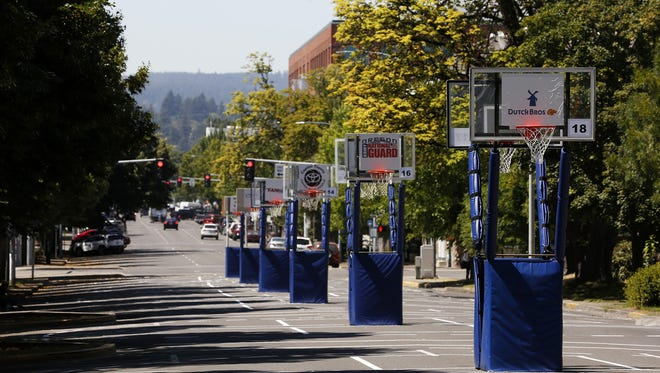 Basketball hoops for Hoopla stand in a line on Court Street near the Oregon Capitol building in Salem, Oregon, on Tuesday, July 31, 2018.