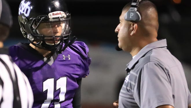 Mission Oak head coach David Flores talks with quarterback Matt Bridges against Frontier in a non-league high school football game at Bob Mathias Stadium on Sept 21, 2017.