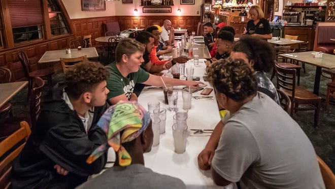 "Football players from Battle Creek Central gather at Clara's on the River every Tuesday for ""Tuesdays with Coach Bess."""