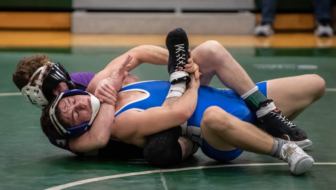 Lakeview's Jacob White and Harper Creek's Jordon Stasa wrestle in the 140-pound weight class during the All-City Meet at Pennfield Wednesday evening.