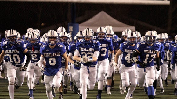 The Highlands Bluebirds take the field in front of a roaring crowd on Friday night against Lexington Catholic.