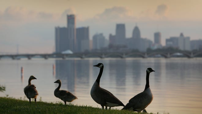 The sun sets on the Detroit skyline viewed from Belle Isle in Detroit on June 4.