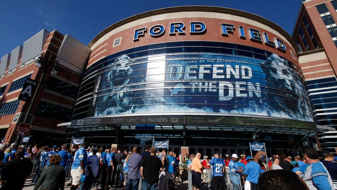 Detroit Lions fans gather outside the main entrance of Ford Field on Sept. 8, 2014.