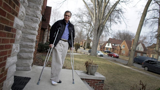 U.S. District Judge Terrence Berg stands on the front of his home March 27, 2015, in Detroit.