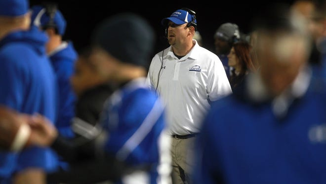 Clear Creek Amana co-head coach Matt Hughes watches his team play Davenport Assumption in Tiffin on Friday, Oct. 10, 2014.   David Scrivner / Iowa City Press-Citizen