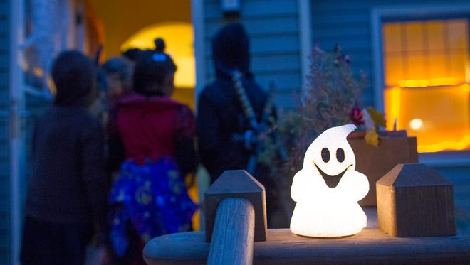 A Halloween decoration sits in front of a house on Friday, Oct. 31, 2014.  David Scrivner / Iowa City Press-Citizen