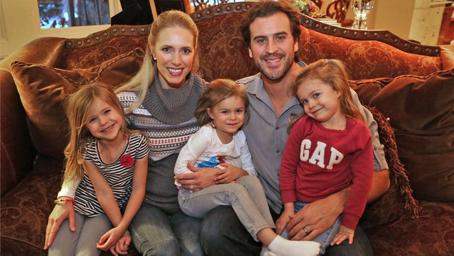 Karyn and Ben Utecht pose with their children Elleora, Amy Joan, and Katriel, in their Lakeville, Minnesota home, Wednesday, November 12, 2014.