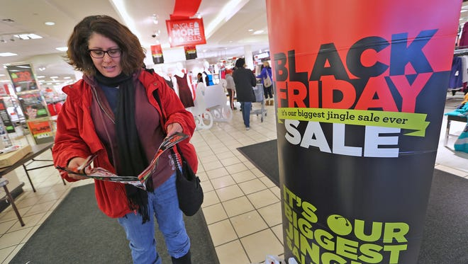 Deb Ellman says that everyone was making friends as they shopped, while at JCPenney at 8752 N. Michigan Rd., during Black Friday shopping, November 28, 2014.