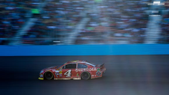 NASCAR driver Kevin Harvick of the Budweiser Chevorlet continues his lead in the 3rd quarter of the Quicken Loans Race for Heroes Sunday November 9, 2014 at Phoenix International Raceway.