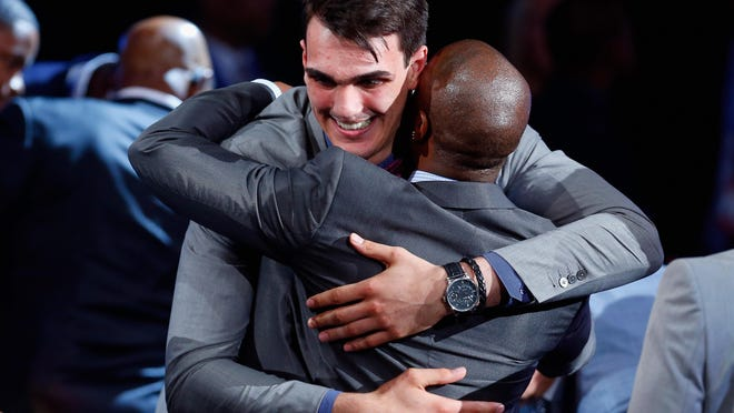 Dario Saric of Croatia celebrates after being drafted with the 12th overall pick by the Orlando Magic on Thursday. Saric was traded to the 76ers afer the selection.