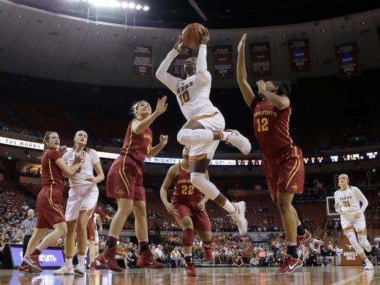 Texas guard Lashann Higgs (10) shoots against Iowa State during the first half of an NCAA college basketball game, Friday, Feb. 24, 2017, in Austin, Texas. (AP Photo/Eric Gay)