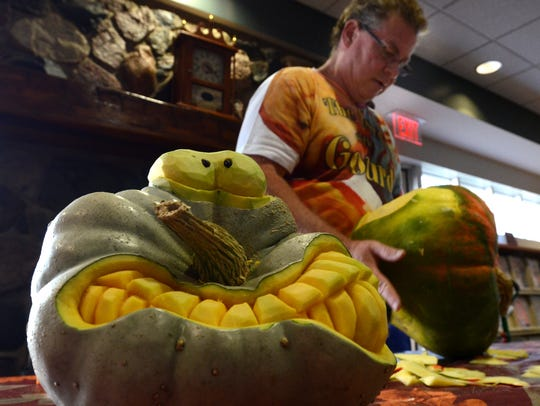 Patrick Harrison, the Lord of the Gourd, carves pumpkins