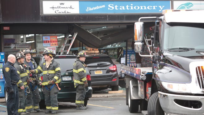 New Rochelle firefighters and police at the scene of a car into a building at the Shoretown Stationary road on Pelham Road on Dec. 27, 2015.