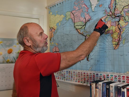 Hans Frischeisen, 73, stands in his Reno home showing the routes he took while cycling around the world. He has bicycled around the globe in several directions. He travels light with little more than a sleeping bag, a tent and some food. Frischeisen, who says his family barely escaped the Red Army invasion into Europe in the 1940s, spends much of his journeys advocating for peace. He also says he's nearing the end of his global cycling days, but he still wants to kayak through the United States from Canada to the Gulf of Mexico.