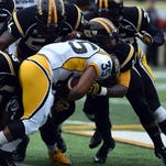 Southern Miss safety D'Nerius Antoine makes a tackle during the annual spring game earlier this year.