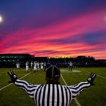The sun sets during a football game Friday, October 2, 2015 at Croswell-Lexington High School.