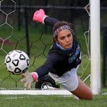 Okemos senior goalie Caroline Serkaian signed to play Division I soccer at the University of Wisconsin- Milwaukee on Signing Day.