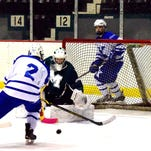 Mason goalie Max Harper had a busy night in the net for the Comets. Here he has another save as St. Xavier's Neil Keyser (2) takes a slap shot at the goal for the Bombers, who scored a 5-0 victory, Jan. 30.